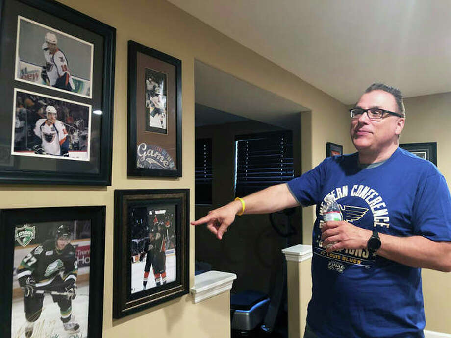 Rob Ferrara points toward photos of his nephew, Patrick Maroon, in his home in St. Louis on Friday. Patrick Maroon had other offers for more money and more years but chose to sign with his hometown St. Louis Blues. He did it for family: for his young son Anthony, his parents and his grandfather, who then died the day before the team left for the playoffs. Photo: Associated Press