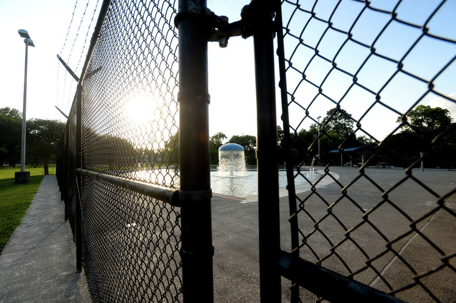 play in the courts outside Alice Keith swimming pool, which has remained closed due to a lack of lifeguards to staff the facility.  Photo taken Wednesday, May 29, 2019 Kim Brent/The Enterprise Photo: Kim Brent/The Enterprise