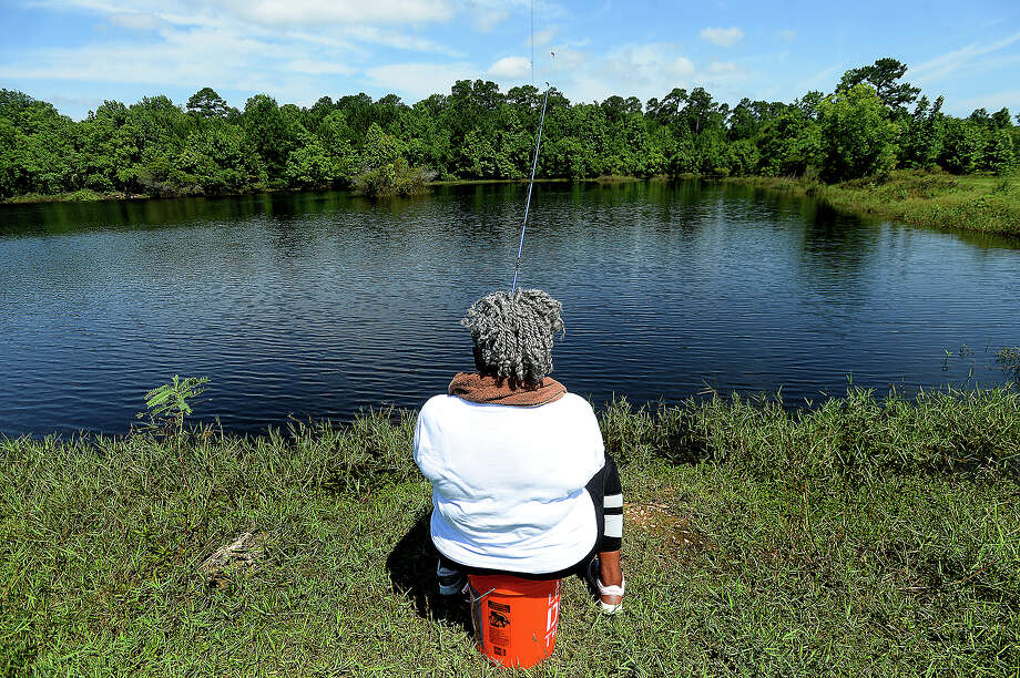 "Cora Wooten casts her line while taking advantage of ""free fishing day"" Saturday at the ponds near the Neches River Saltwater Barrier in Beaumont. Fishing enthusiasts could enjoy a day of fishing without the usual required license throughout the state. Wooten says she has been fishing since a child, and the family memories it brings and peace of spending a quiet day on the water is what draws her to the sport, one which she has passed on to her own children and grandchildren. Photo taken Saturday, June1, 2019 Kim Brent/The Enterprise Photo: Kim Brent/The Enterprise"