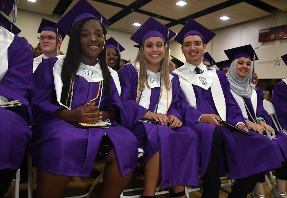 Graduates Brianna Kyei, from left, Adelyn CHavez, Nicholas Alvarado, and Lujain Alyousef wait for the recessional after receiving their diplomas during the Spring Early College Academy commencement ceremony in the gymnasium at Lone Star College - North Harris on June 1, 2019. Photo: Jerry Baker, Houston Chronicle / Contributor / Houston Chronicle