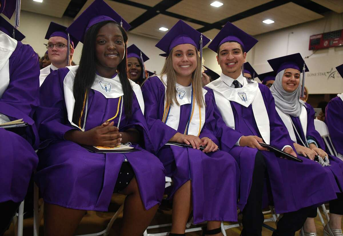 Graduates Brianna Kyei, from left, Adelyn CHavez, Nicholas Alvarado, and Lujain Alyousef wait for the recessional after receiving their diplomas during the Spring Early College Academy commencement ceremony in the gymnasium at Lone Star College - North Harris on June 1, 2019.