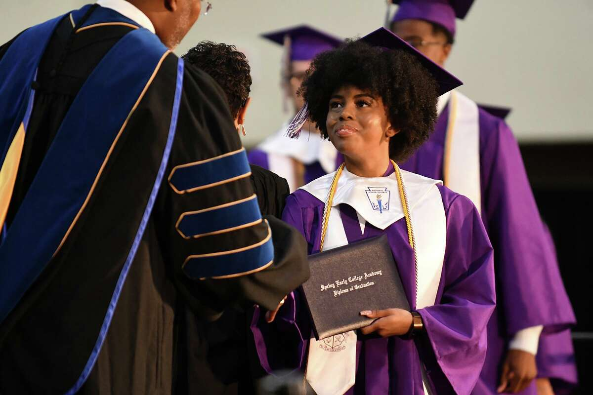 Class Valedictorian Autumn Smith, right, receives her diploma from Spring ISD Superintendent Rodney Watson, Ph.D., during the Spring Early College Academy commencement ceremony in the gymnasium at Lone Star College - North Harris on June 1, 2019.