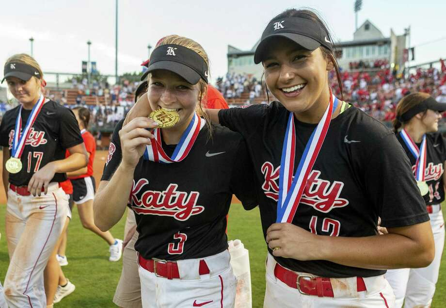 Katy short stop Chloe Woodward (5) and second baseman Amy Hitt (12) celebrate a 8-2 win over Klein Collins with their gold medals during the UIL Class 6A state softball championship in Austin on Saturday, June 1, 2019. Photo: Stephen Spillman / Stephen Spillman / stephenspillman@me.com