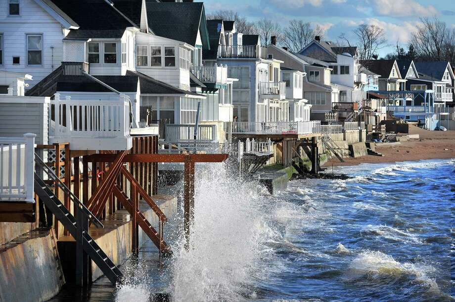Waves crash against the homes along Townsend Avenue in Morris Cove in the late afternoon as strong winds battered the shore most of the day in 2013. Photo: Peter Casolino / Hearst Connecticut Media File Photo
