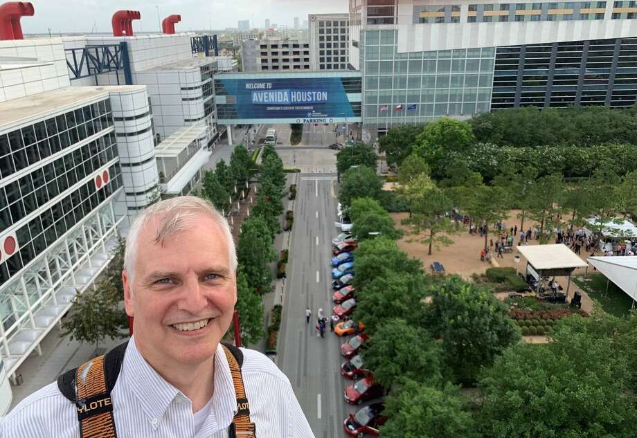 Houston Electric Auto Association President Dave Hanson poses for a photo looking on the the George R. Brown Convention Center, where across the street various electric vehicles are on display during the American Wind Energy Association conference in late May. Photo: Courtesy Photo