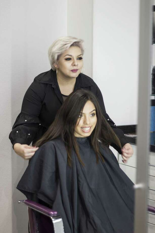 A cosmetology professional offers first-hand learning experience of operating a salon to a student. Photo: Courtesy Photo