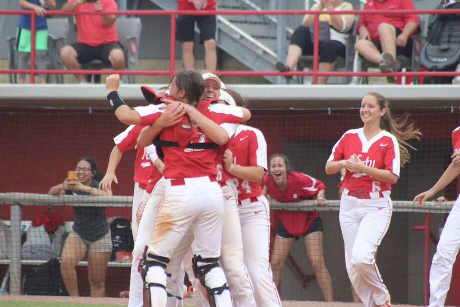 Katy High School's players begin celebrating their Region III softball title over Deer Park back on May 23. Saturday night, the Lady Tigers won the state crown. Photo: Robert Avery