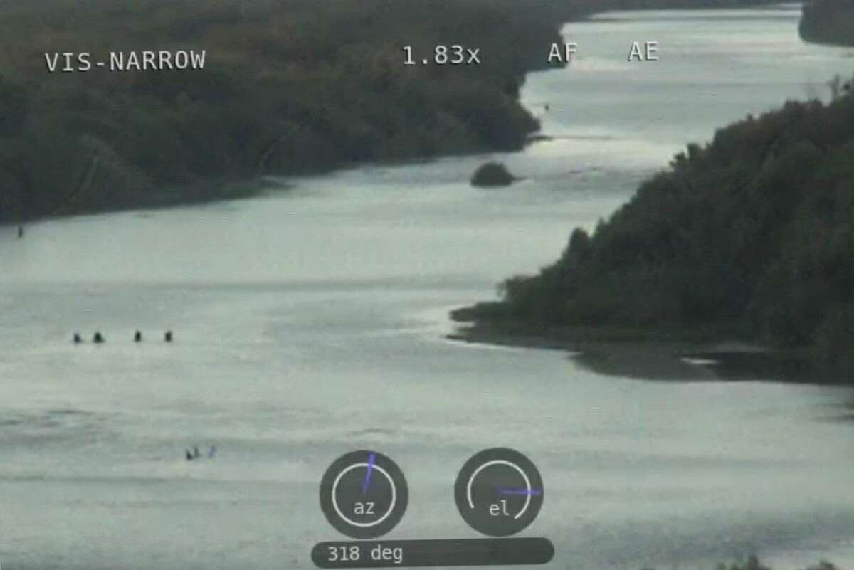 The Webb County Sheriff's Office said people can be seen in this photo crossing the Rio Grande.