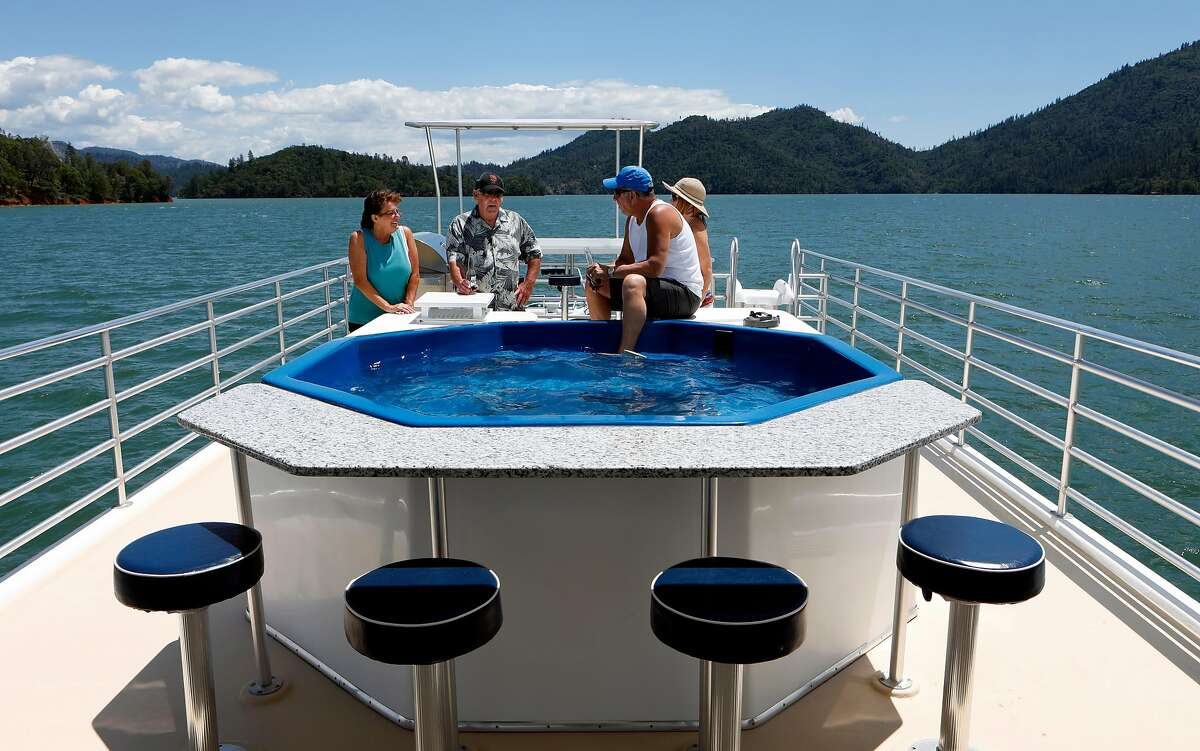 (l to r) Anna and John Harkrader and Joan and Dave Patters enjoy the top deck aboard their houseboat rental during a weekend trip on Shasta Lake, Ca., as seen on Friday May 31, 2019.