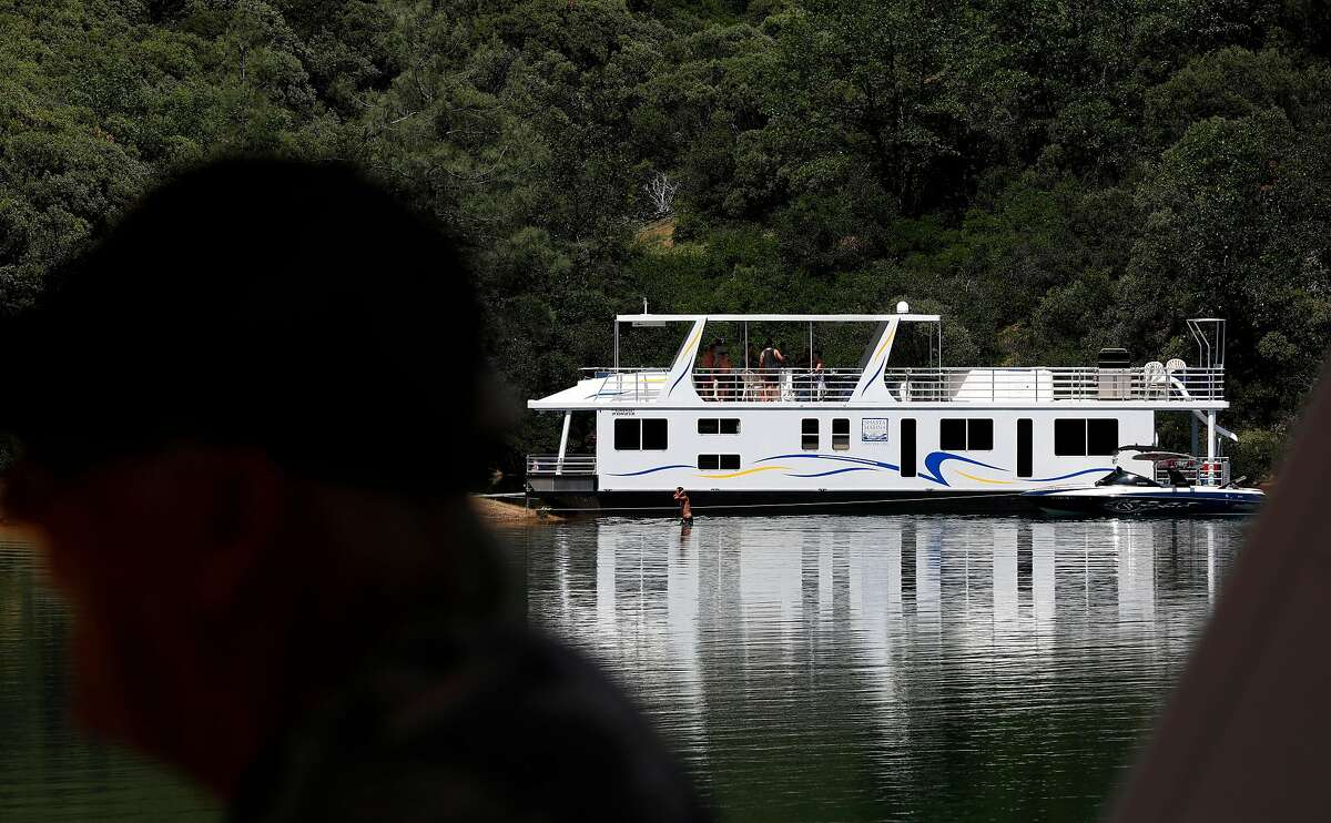 A houseboat pulled up into a quiet cove on Shasta Lake, Ca., as seen on Friday May 31, 2019.
