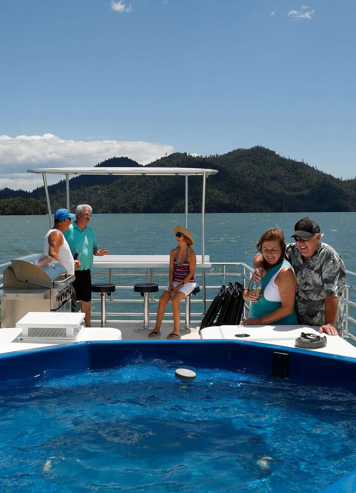 ( l to r) Dave Patters, Brad Castillo, Joan Patters and Anna and John Harkrader, on their houseboat rental during a weekend trip on Shasta Lake, Ca., as seen on Friday May 31, 2019.