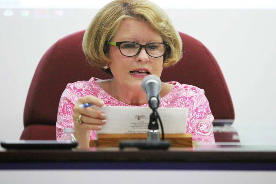 New Dayton mayor Caroline Wadzeck reads a motion during her first city council meeting. Wadzeck ran unopposed and is the first woman elected to the mayor's office. Photo: David Taylor / Staff Photo