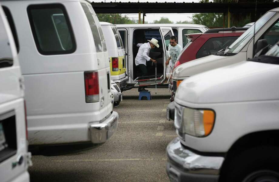 Close to 50 vans from different adult daycare centers in the Rio Grande Valley pack the parking lot at flea market Pulga Los Portales in Mission, TX as they visit during senior citizen day on Wednesday, May 22, 2013. Photo: Bob Owen / San Antonio Express-News / © 2012 San Antonio Express-News