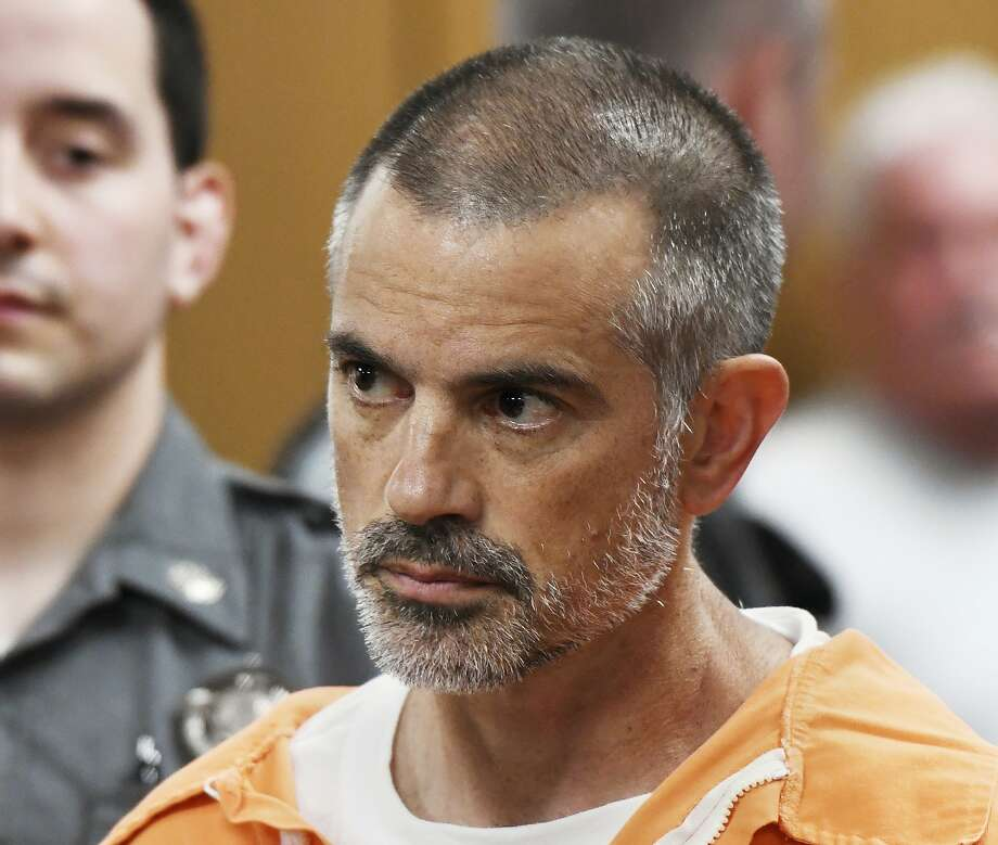 Fotis Dulos is arraigned on charges of tampering with or fabricating physical evidence and first-degree hindering prosecution at Norwalk Superior Court in Norwalk, Conn. Monday, June 3, 2019. Fotis Dulos, and his girlfriend, Michelle C. Troconis, were arrested at an Avon hotel late Saturday night and held on a $500,000 bond for charges of tampering with or fabricating physical evidence and first-degree hindering prosecution. Fotis Dulos is the estranged husband of Jennifer Dulos, the 50-year-old mother of five who has been missing since May 24. (Tyler Sizemore/Hearst Connecticut Media via AP, Pool) Photo: Tyler Sizemore, Associated Press