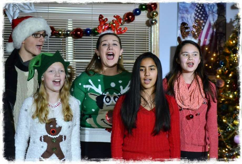 Harrison Gilberti, Cate Wisneski, Sophia Santos, Srishti Pithadia and Elena Kemper sing at the first annual Holly Jolly Show sing at Trumbull Youth Association's first annual Holly Jolly Show, which brought plenty of holiday cheer at the VFW Center Dec. 19. — Lisa Romanchick photo