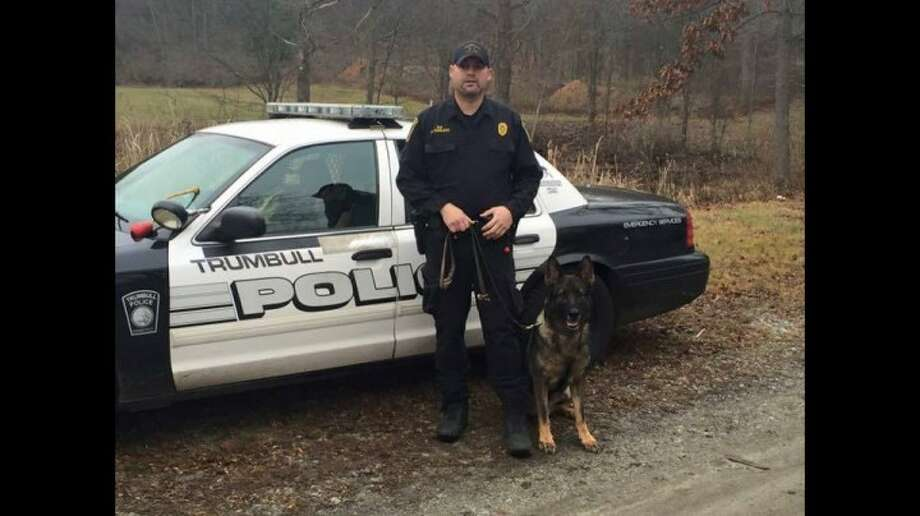 Trumbull police officer Greg Lee with K9 officer Storm.