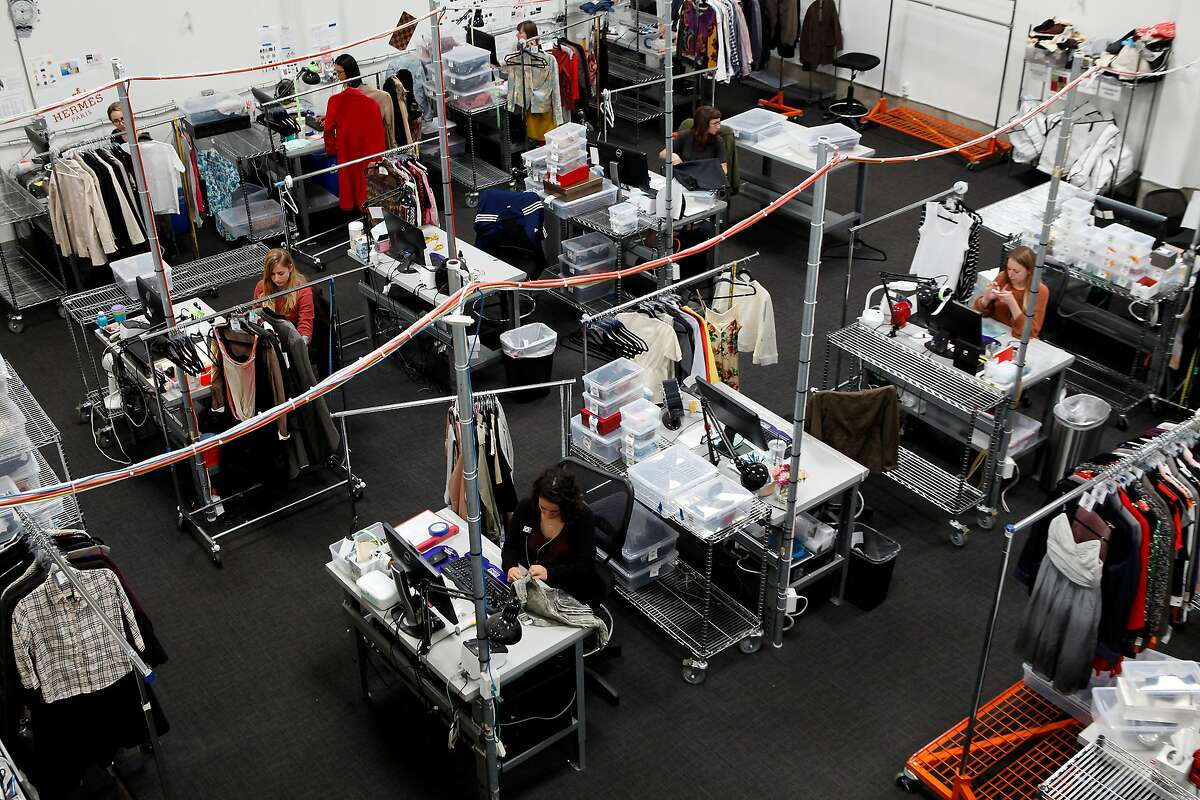 Employees work in the authentication department, where items are checked for authenticity and wear and tear, at the headquarters of online luxury resale and consignment company The RealReal in San Francisco, CA, Wednesday June 18, 2014.