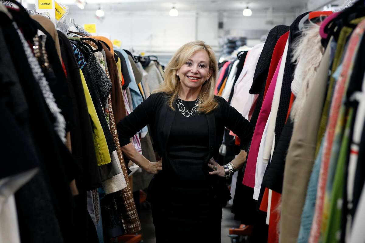 Founder and CEO Julie Wainwright stands among racks of clothing at the headquarters of her online luxury resale and consignment company The RealReal in San Francisco, CA, Wednesday June 18, 2014.