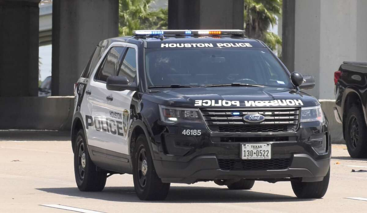 Houston police officers investigate a crash that sent two juveniles to Texas Children's Hospital along the Gulf Freeway on Monday, June 3, 2019.
