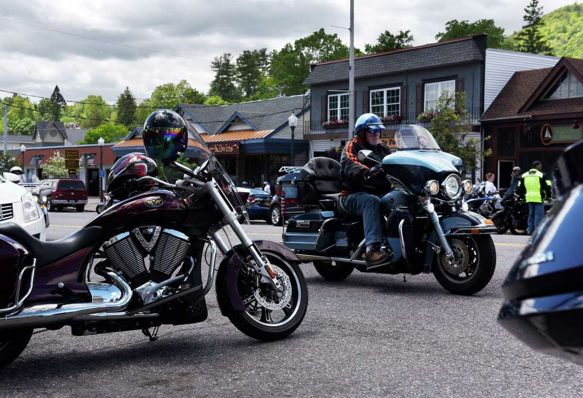 Bikers ride down Route 9N through Lake George Village during the start of Americade, the annual motorcycle rally that draws thousands of riders to the village surrounding Adirondack Mountains, on Monday, June 3, 2019, in Lake George, N.Y. The annual event runs through Saturday. (Will Waldron/Times Union)