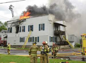 Firefighters work on putting out a house fire on the corner of Rt. 5S and Lock St. on Monday, June 3, 2019 in Rotterdam Junction, N.Y. (Lori Van Buren/Times Union)