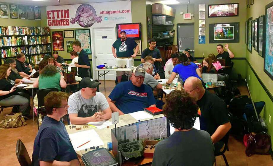 PHOTOS: Members of Dungeons & Dragons of the Greater Houston Area gather to play a game.