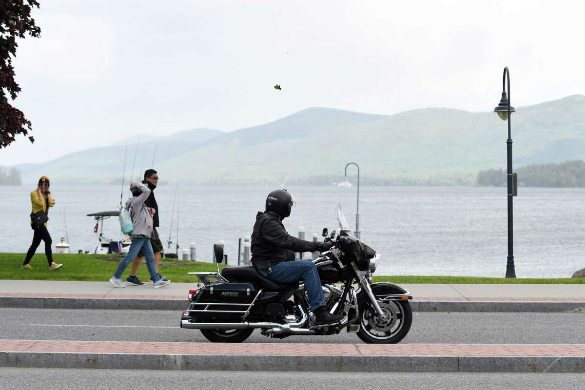 A biker cruises down Beach Road in Lake George Village at the start of Americade, the annual motorcycle rally that draws thousands of riders to the village surrounding Adirondack Mountains, on Monday, June 3, 2019, in Lake George, N.Y. The event runs through Saturday. (Catherine Rafferty/Times Union)