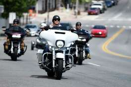 Bikers drive down Route 9N in Lake George Village for the start of Americade, the annual motorcycle rally that draws thousands of riders to the village surrounding Adirondack Mountains, on Monday, June 3, 2019, in Lake George, N.Y. The event runs through Saturday. (Catherine Rafferty/Times Union)