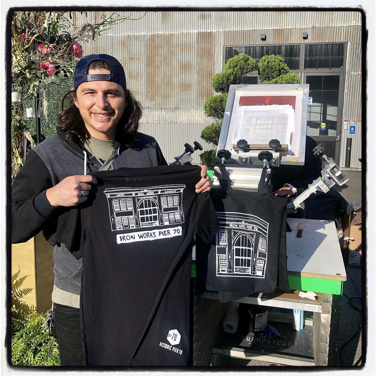 San Franpyscho cofounder Christian Routzen live prints T-shirts at Pier 70. May 29, 2019.