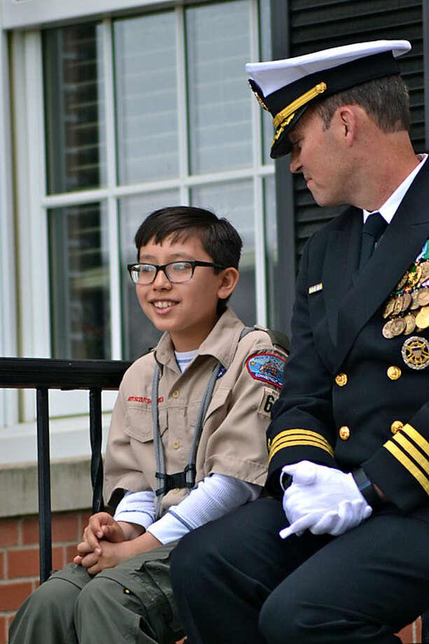 Winner of Memorial Day theme contest Brayden Crumb with Grand Marshal Rick McCarthy Commander, USN, Retired (Lisa Romanchick photo)