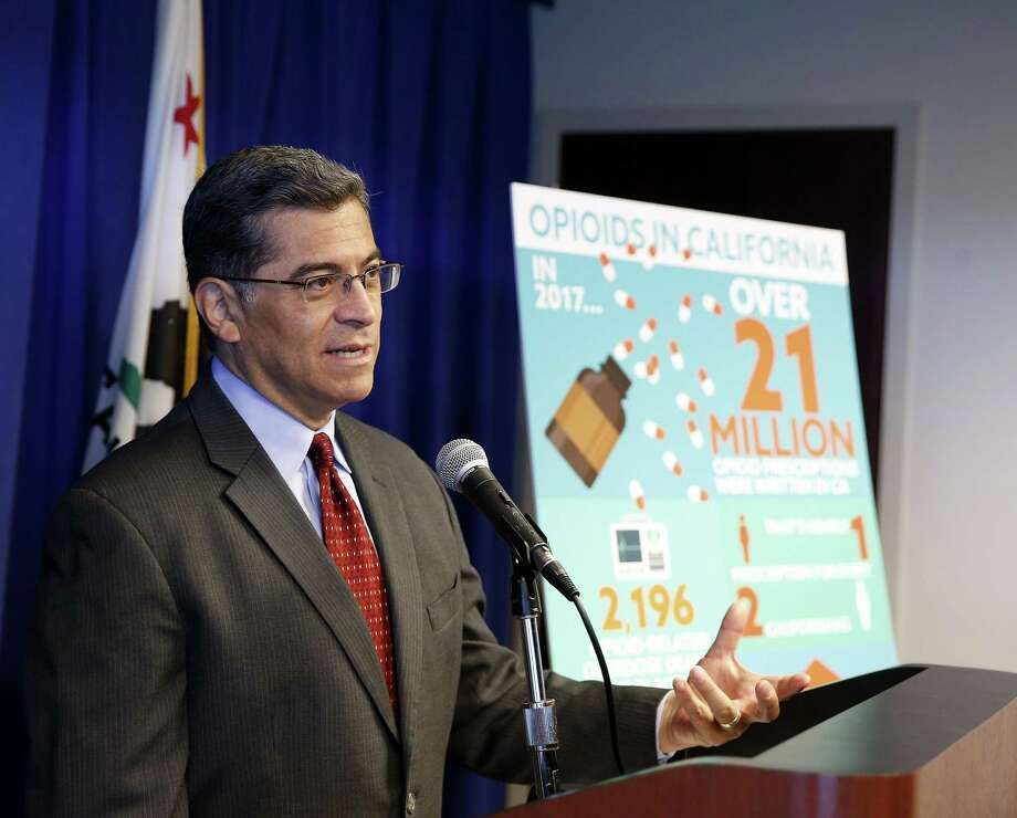 California Attorney General Xavier Becerra discusses the lawsuit his office has filed to Purdue Pharma for it's painkiller Oxycontin, during a news conference, Monday, June 3, 2019, in Sacramento, Calif. The suit, filed against Purdue and its former president, Dr. Richard Sackler, alleges it falsely promoted the drug as not addictive even as it emerged as among of the most widely abused in the United States. (AP Photo/Rich Pedroncelli) Photo: Rich Pedroncelli / Associated Press / Copyright 2019 The Associated Press. All rights reserved