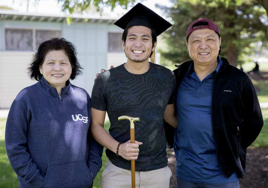 By working harder, immigrants make the rest of us feel inferior. Take Jirayut New Latthivongskorn, shown with his parents. He's the first undocumented immigrant to graduate from the University of California, San Francisco's School of Medicine. Photo: Jessica Christian / San Francisco Chronicle / ONLINE_YES