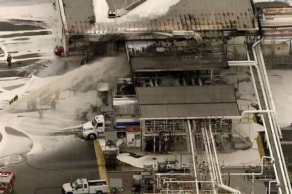 Cameras from Los Angeles-based television station KTLA-TV captured and aerial view of firefighter putting out a Monday morning fire at a Kinder Morgan fuel rack in Carson, California. The cause of the fire remains under investigation. Los Angeles County Fire Department officials said a shipment of jet fuel ignited sending a truck driver to the hospital.