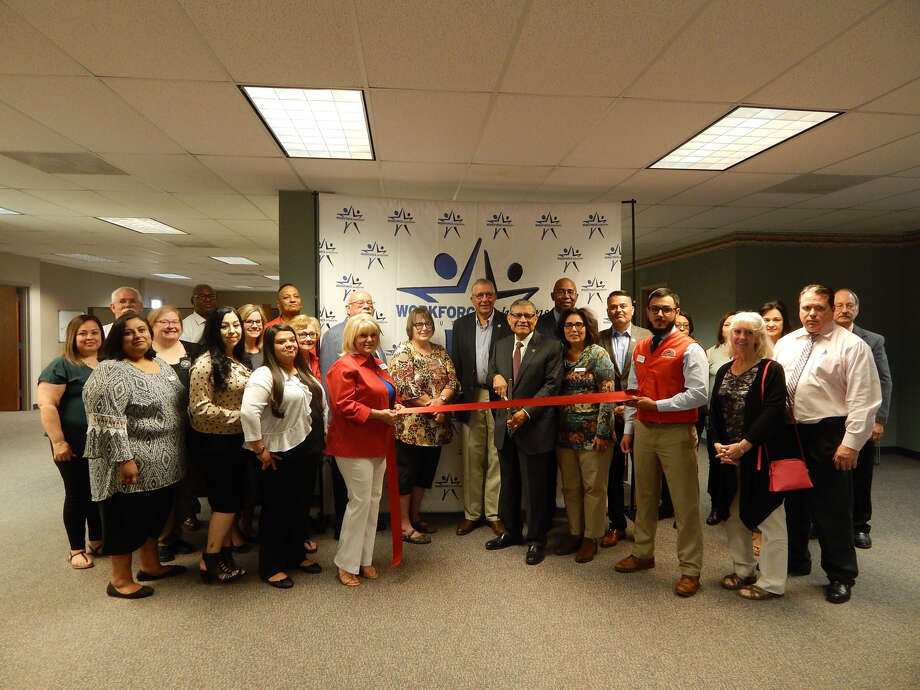 Texas Workforce Solutions South Plains Plainview board members, Plainview Chamber of Commerce Ambassadors and local business leaders cut ribbon at the new Workforce Solutions office to celebrate the change in location. Photo: Chamber Of Commerce/Courtesy Photos