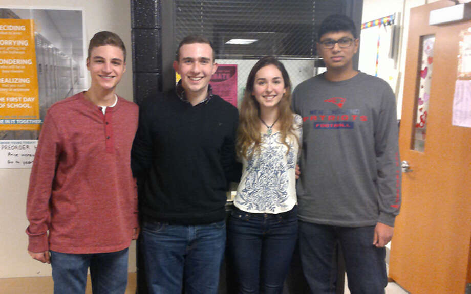 The Trumbull High School debate team includes Michael Kenler, Ben Hazen, Emma Thornton and Aravind Sureshbabu. Their coach is teacher Hope Spalla.