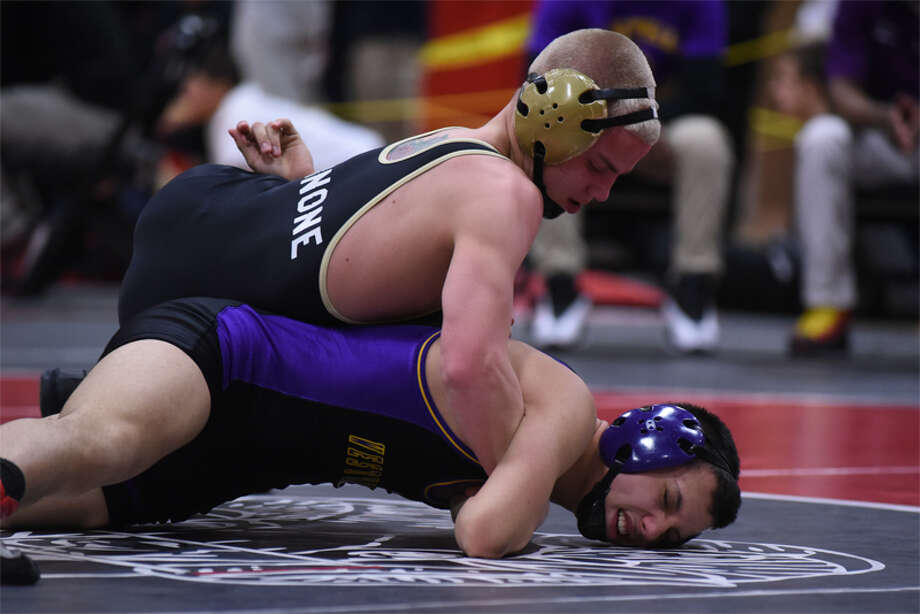 Cross Cannone grapples with Westhill's Brandon Chejin during a Friday evening match. (Dave Stewart/Hersam Acorn Newspapers Photo)