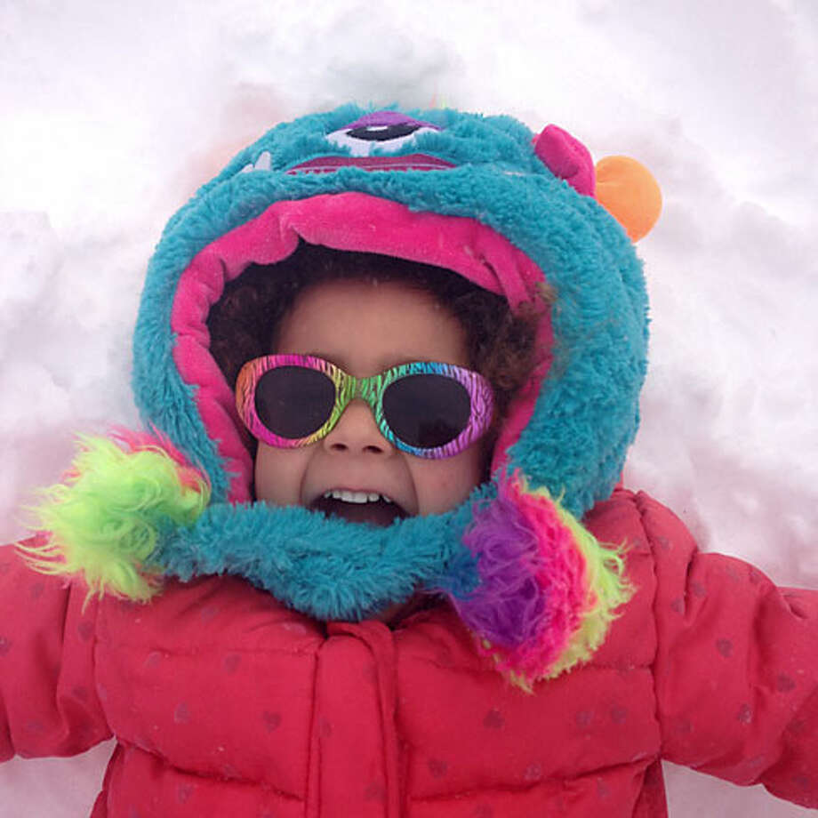 Marley Gipson, 3, brightens up the snow.