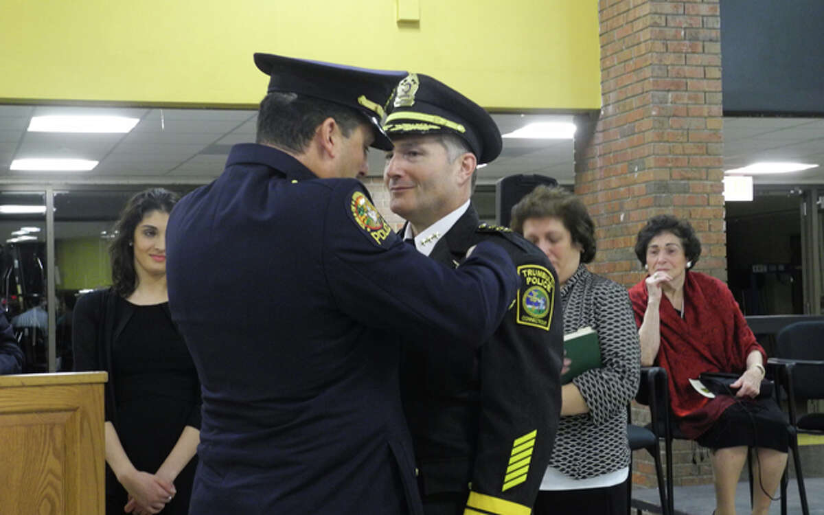 Chief Michael Lombardo's brother, Robert pins the badge on his brother. Robert Lombardo is a lieutenant with the Greenwich Police.