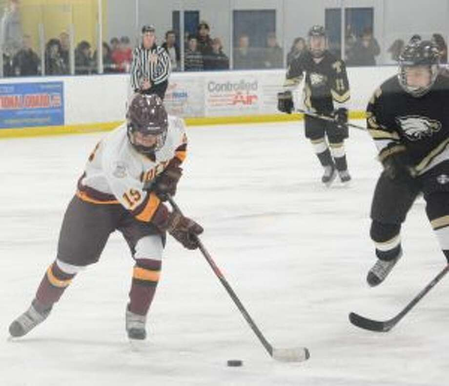St. Joseph's Matt Lally brings the puck up ice in the Cadets game with Trumbull High. — Andy Hutchison photo