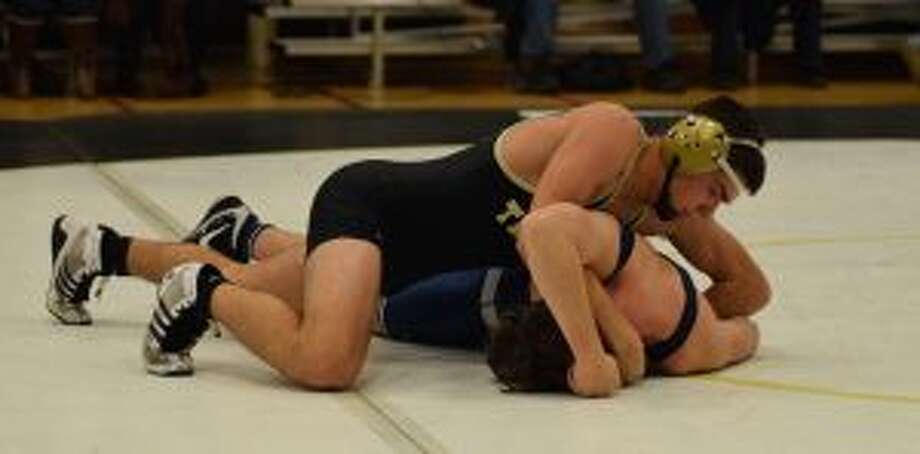 Trumbull's Brian Wallace works towards a pin in his 160-pound match. — Dee Sollenberger photo
