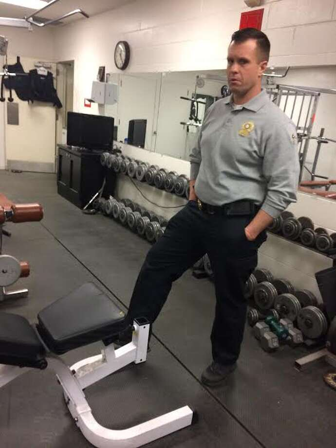 Sgt. Brian Falkenstein and the Trumbull Rotary hope to renovate the Police Department's 1980s-vintage workout room. — Donald Eng