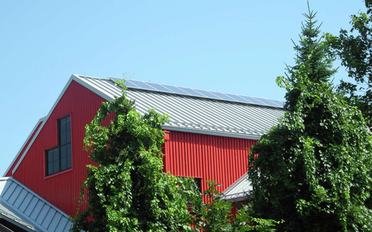 Solar panels, like the ones on the roof of the Agriscience and Biotechnology building, are helping cut the school system's energy cost in half.
