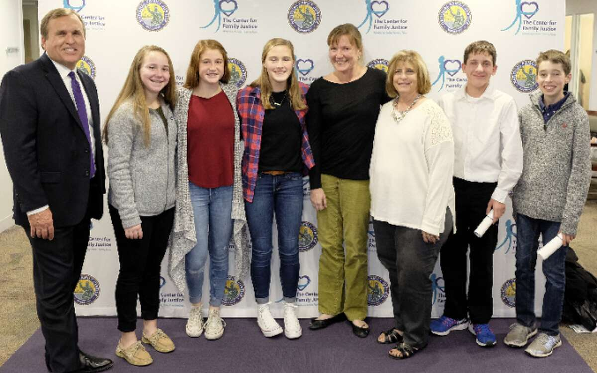 Casey Gwinn, author of Cheering for Children and founder of the Family Justice Center movement with members of the KARE Club at Madison Middle School. From Left to Right: Casey Gwinn, Bailey McGuigan, Katie McLaughlin, Emma LeClerc, Jeanne Malgioglio, Nancy Yarmosh, Shane Miller, and Connor Downs.