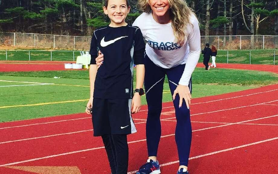 Track Friday coordinator Heidi Langan and her son Jaden Buchetto, 10, at last year's event.