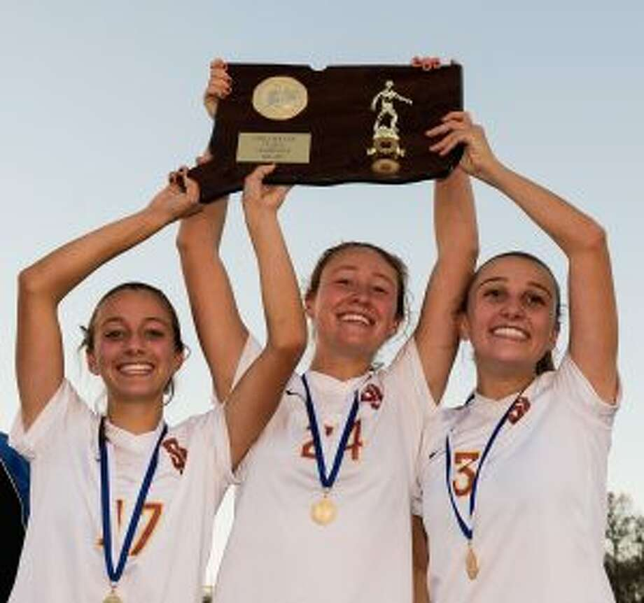 St. Joseph High senior captains, Christina DiCesare, Lindsey Savko and Sophia Smith, raise the Class L trophy. — David G. Whitham photos