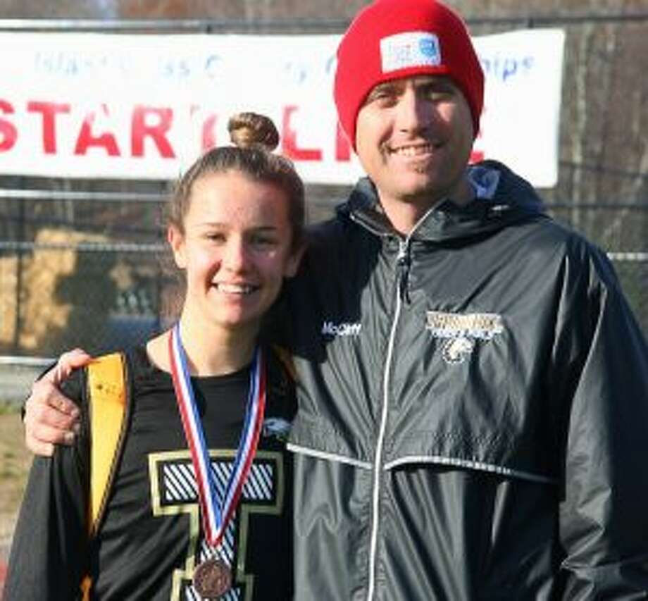 Trumbull High's Kate Romanchick, pictured with Eagle coach Jim McCaffrey, placed 25th and medaled at the New England Cross Country Championships.