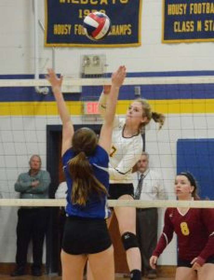 St. Joseph's Elena Ball goes up for a spike against Seymour High. — Andy Hutchison photo