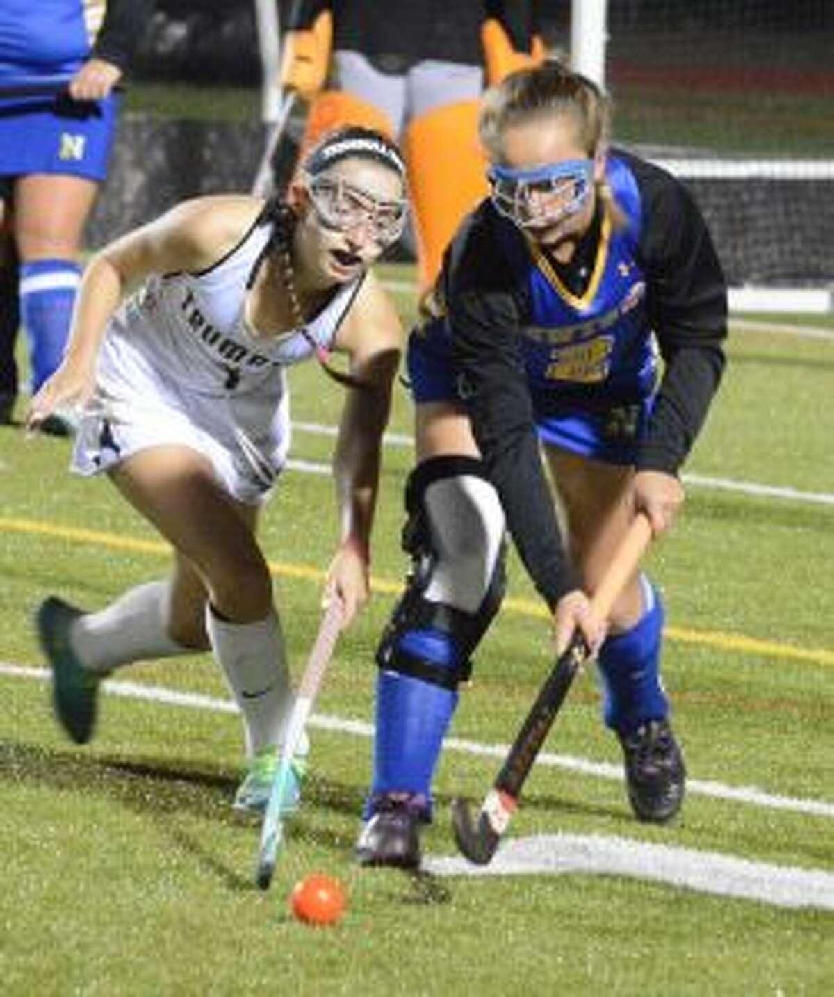 Trumbull's Hayley Adams look to possess ball versus Newtown. - Andy Hutchison photo
