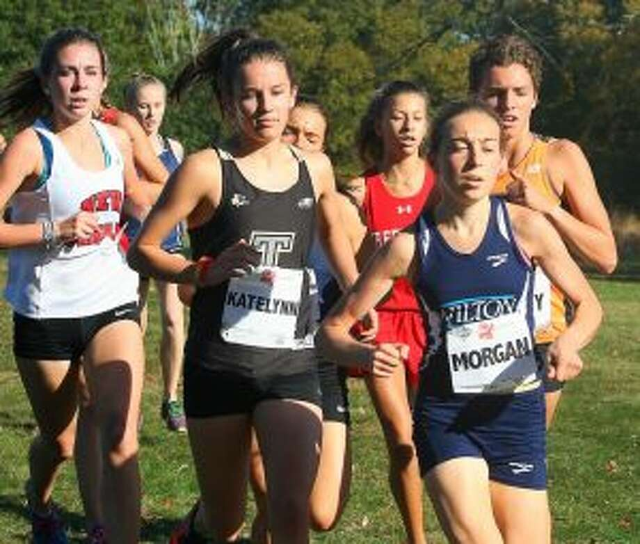 Trumbull High's Kate Romanchick has Wilton High's Morgan McCormick in her sights at the FCIAC Championships.