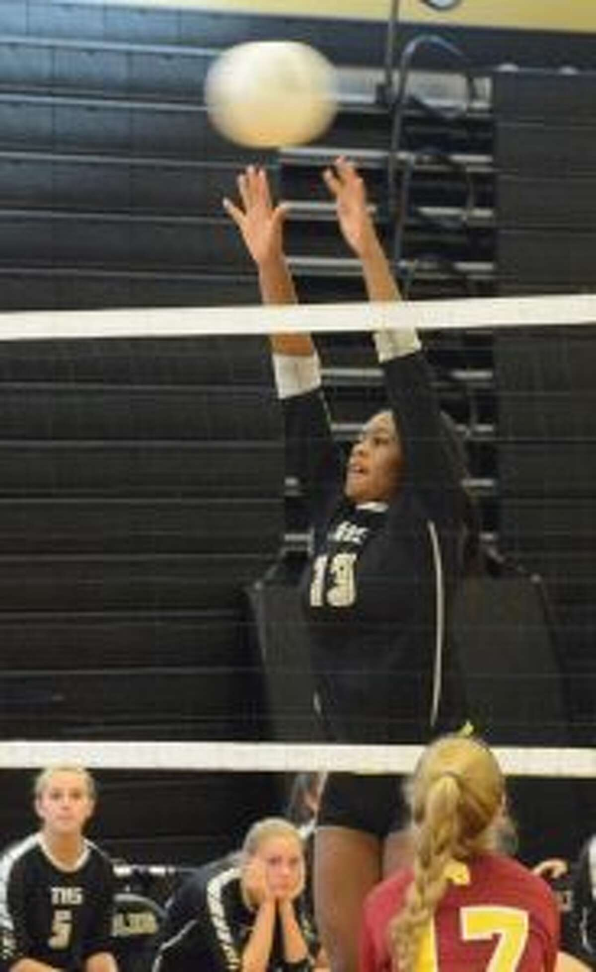 Trumbull High's Imani Bell goes up for a block. - Andy Hutchison photo
